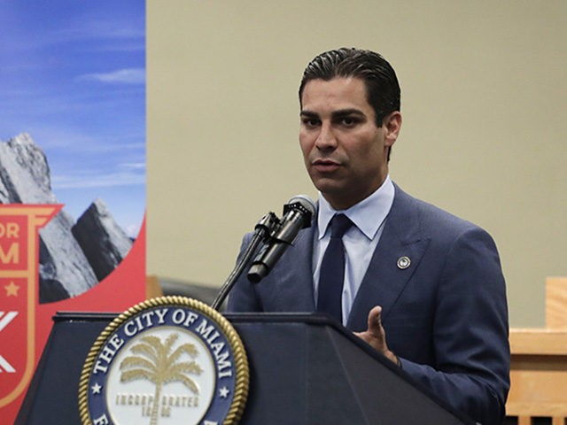 Miami Mayor Francis Suarez speaks during a news conference regarding local efforts to support the Venezuelan democracy movement, at Miami City Hall, Monday, July 22, 2019, in Miami. The City of Miami will host a 5K run July 28 to raise money for the movement. (AP Photo/Lynne Sladky)