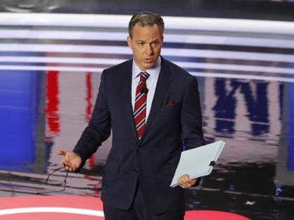 Jake Tapper speaks before the first of two Democratic presidential primary debates hosted by CNN Tuesday, July 30, 2019, in the Fox Theatre in Detroit. (AP Photo/Paul Sancya)