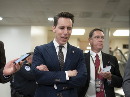 Sen. Josh Hawley, R-Mo., speaks with reporters in Washington, Friday, Jan. 24, 2020. (AP Photo/J. Scott Applewhite)