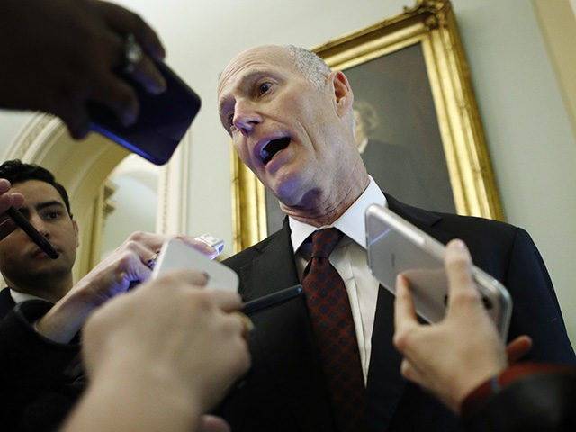 Sen. Rick Scott, R-Fla., talks to reporters prior to the start of the impeachment trial of President Donald Trump at the Capitol, Wednesday, Jan 29, 2020, in Washington. (AP Photo/Steve Helber)