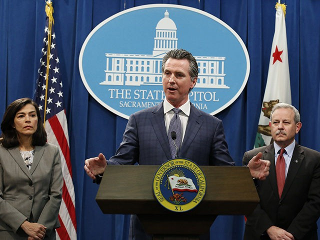 In the aftermath of the first California resident to die from the coronavirus, California Gov. Gavin Newsom declared a statewide emergency to deal with the virus, at a Capitol news conference in Sacramento, Calif., Wednesday, March 4, 2020. The elderly patient died in Placer County, northeast of Sacramento, after apparently …