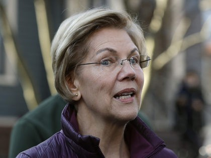 Sen. Elizabeth Warren, D-Mass., speaks to the media outside her home Thursday, March 5, 2020, in Cambridge, Mass., after she dropped out of the Democratic presidential race. (AP Photo/Steven Senne)