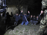Greek Army arrest migrants in the village of Kastanies, Evros region, near the Greek-Turkish border on Friday, March 6, 2020. (AP Photo/Giannis Papanikos)