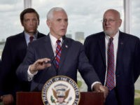 Vice President Mike Pence, center, along with Florida Gov. Ron DeSantis, left, and CDC Director Dr. Robert Redfield, right, speaks to the media after a meeting with cruise line company leaders to discuss the efforts to fight the spread of the COVID-19 coronavirus, at Port Everglades, Saturday March 7, 2020, …