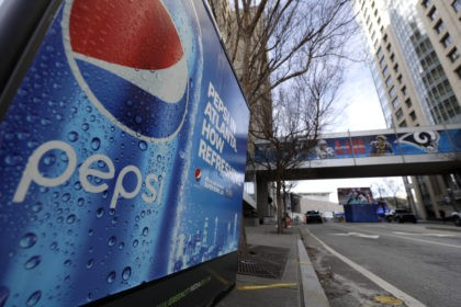 FILE - In this Jan. 30, 2019, file photo, an advertisement for Pepsi is shown downtown for the NFL Super Bowl 53 football game in Atlanta. PepsiCo says it's buying energy drink maker Rockstar Energy Beverages for $3.85 billion. PepsiCo and Coca-Cola have moved aggressively in their pursuit of consumers …