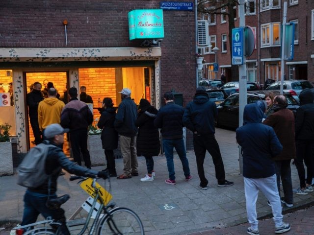 People queue to buy marijuana at coffeeshop Bulwackie in Amsterdam, Netherlands, Sunday, March 15, 2020, after a TV address of health minister Bruno Bruins who ordered all Dutch schools, cafes, restaurants, coffeeshops and sport clubs to be closed on Sunday as the government sought to prevent the further spread of …