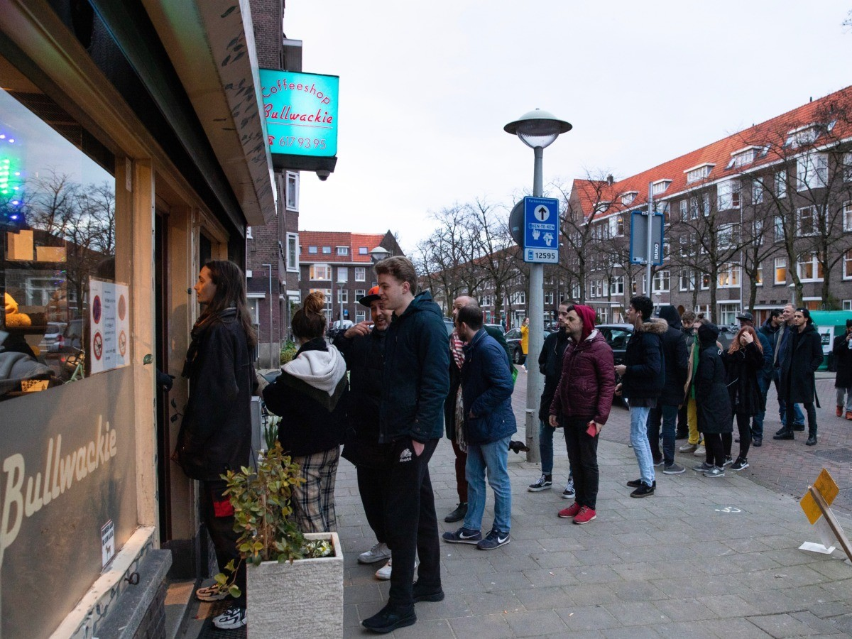 People queue to buy marijuana at coffeeshop Bulwackie in Amsterdam, Netherlands, Sunday, March 15, 2020, after a TV address of health minister Bruno Bruins who ordered all Dutch schools, cafes, restaurants, coffeeshops and sport clubs to be closed on Sunday as the government sought to prevent the further spread of coronavirus in the Netherlands. For most people, the new coronavirus causes only mild or moderate symptoms, such as fever and cough. For some, especially older adults and people with existing health problems, it can cause more severe illness, including pneumonia. (AP Photo/Peter Dejong)