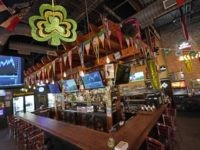 The bar is empty at Mo's Irish Pub on St. Patrick's Day, Tuesday, March 17, 2020, in Houston. Houston area bars and restaurants have been ordered to follow new restrictions for the next 15 days in an effort to curb coronavirus exposure. Bars and nightclubs must close and restaurants can …