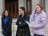 FILE - In this Feb. 12, 2020 file photo, high school track athletes Alanna Smith, left, Selina Soule, center and and Chelsea Mitchell prepare to speak at a news conference outside the Connecticut State Capitol in Hartford, Conn. The three girls have filed a federal lawsuit to block a state …