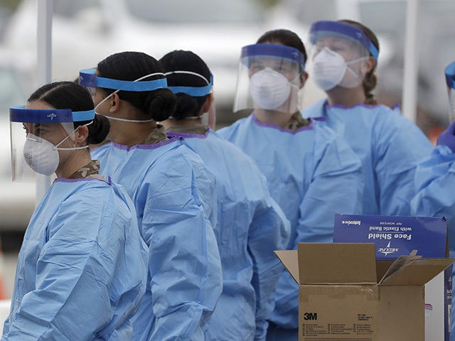 Another shift of medical staff prepare to start woking at a drive-through testing center for COVID-19 in Paramus, N.J., Friday, March 20, 2020. The coronavirus testing center opened Friday in Bergen County which has been the state's hardest-hit area. Gov. Phil Murphy said only those with symptoms should get in …