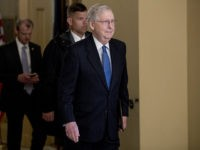 Senate Majority Leader Mitch McConnell of Ky. walks to the Senate Chamber on Capitol Hill in Washington, Monday, March 23, 2020, as the Senate is working to pass a coronavirus relief bill. (AP Photo/Andrew Harnik)