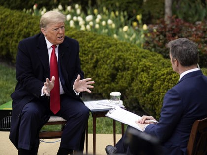President Donald Trump speaks with Fox News Channel Anchor Bill Hemmer during a Fox News Channel virtual town hall, at the White House, Tuesday, March 24, 2020, in Washington. (AP Photo/Evan Vucci)