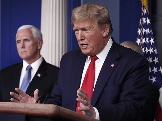 President Donald Trump speaks about the coronavirus in the James Brady Briefing Room, Tuesday, March 24, 2020, in Washington, as Vice President Mike Pence listens. (AP Photo/Alex Brandon)