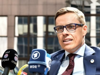 Finland's Prime minister Alexander Stubb addresses reporters upon his arrival at the European Council headquarters for an extraordinary summit of European leaders to deal with a worsening migration crisis, on April 23, 2015 in Brussels. European leaders gather on April 23 to consider military action, at an extraordinary summit to …