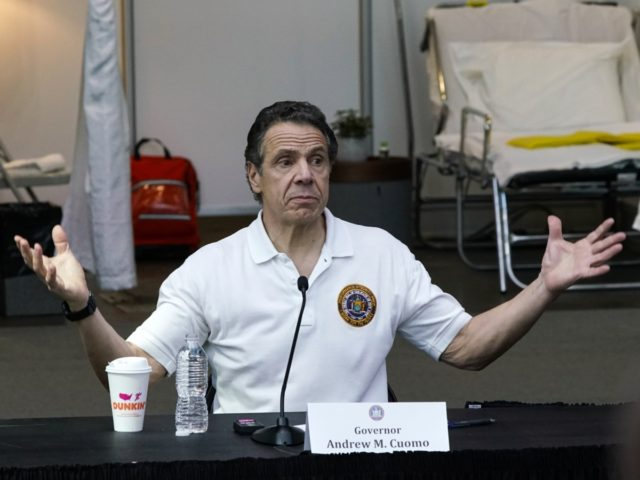 NEW YORK, NY - MARCH 27: New York Gov Andrew Cuomo gives a daily coronavirus press conference in front of media and National Guard members at the Jacob K. Javits Convention Center, which is being turned into a hospital to help fight coronavirus cases on March 27, 2020 in New …