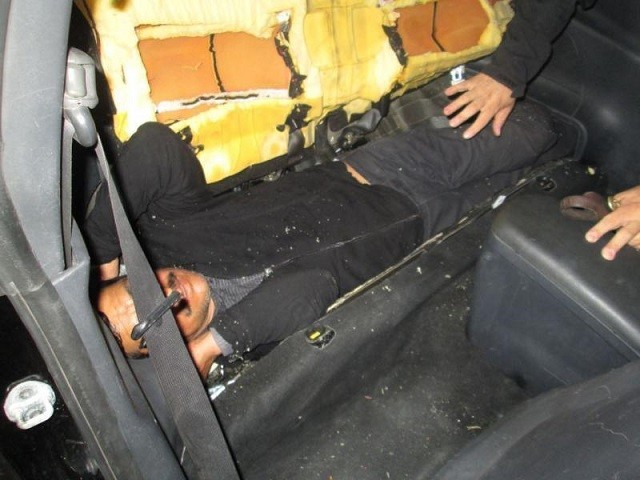 CBP officers find a man stashed inside the rear seat of a Mitsubishi sedan. (Photo: U.S. Customs and Border Protection/El Centro Sector)