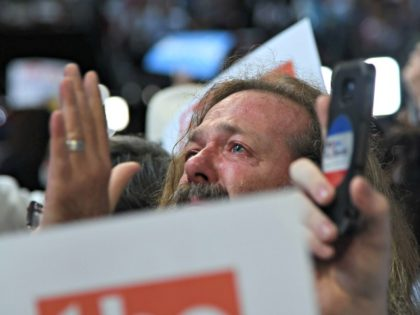 A delegate from New York state reacts as the brother of Vermont Senator Bernie Sanders announces the delegate vote from abroad during the roll call on Day 2 of the Democratic National Convention at the Wells Fargo Center in Philadelphia, Pennsylvania, July 26, 2016. / AFP / Robyn BECK (Photo …