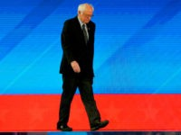 Democratic presidential hopeful Vermont Senator Bernie Sanders walks onstage as he arrives for the eighth Democratic primary debate of the 2020 presidential campaign season co-hosted by ABC News, WMUR-TV and Apple News at St. Anselm College in Manchester, New Hampshire, on February 7, 2020. (Photo by Joseph Prezioso / AFP) …