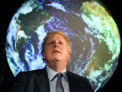 Britain's Prime Minister Boris Johnson reacts during an event to launch the United Nations' Climate Change conference, COP26, in central London on February 4, 2020. - Britain will bring forward a ban on sales of new petrol and diesel vehicles to 2035, including hybrids, Prime Minister Boris Johnson was to …