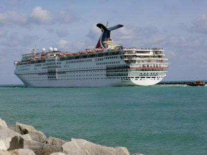In this Monday, May 19, 2014 photo, the Carnival Cruise Lines ship Ecstasy leaves the Port of Miami as it passes Miami Beach, Fla. (AP Photo/Lynne Sladky)