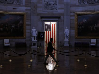 WASHINGTON, DC - MARCH 24: A man walks through the U.S. Capitol Rotunda, empty of tourists as only essential staff and journalists are allowed to work during the coronavirus pandemic March 24, 2020 in Washington, DC. After days of tense negotiations -- and Democrats twice blocking the nearly $2 trillion …