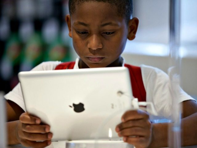 A Brazilian boy looks at an ipad at the retail shop of Apple products in Sao Paulo. Steve Jobs, co-founder and former CEO of Apple Inc, died on October 5, 2011 from cancer at 56. Jobs co-founded Apple in 1976 and is credited with marketing the world's first personal computer …