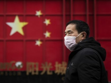 WUHAN, CHINA - FEBRUARY 10: A man wears a protective mask on February 10, 2020 in Wuhan, China. Flights, trains and public transport including buses, subway and ferry services have been closed for the nineteenth day. The number of those who have died from the Wuhan coronavirus, known as 2019-nCoV, …