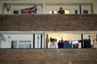 "MANCHESTER, - MARCH 26: People applaud the NHS from their balconies and gardens across the road from Wythenshawe Hospital on March 26, 2020 in Manchester, United Kingdom. The ""Clap For Our Carers"" campaign has been encouraging people across the U.K to take part in the nationwide round of applause from …"