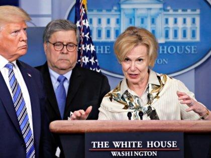 President Donald Trump and Attorney General William Barr listens as Dr. Deborah Birx, White House coronavirus response coordinator, speaks about the coronavirus in the James Brady Briefing Room, Monday, March 23, 2020, in Washington. (AP Photo/Alex Brandon)