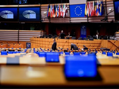 Members of the EU Parliament arrive and sit in an empty hemicycle at the beginning of the plenary session which is reduced to a single day due to the spread of the COVID-19 illness, in Brussels, on March 10, 2020. - All European Union States are hit by the novel …