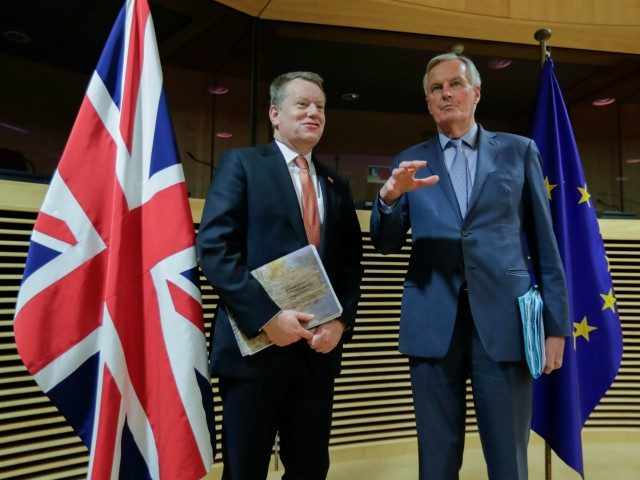 European Union chief Brexit negotiator Michel Barnier (R) and the British Prime Minister's Europe adviser David Frost speak at start of the first round of post-Brexit trade deal talks between the EU and the United Kingdom, in Brussels on March 2, 2020. (Photo by Olivier HOSLET / POOL / AFP) …