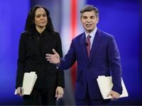 ABC Chief Anchor George Stephanopoulos, right, and ABC News Live Anchor Linsey Davis, left, address members of the audience Friday, Feb. 7, 2020, before the start of a Democratic presidential primary debate hosted by ABC News, Apple News, and WMUR-TV at Saint Anselm College in Manchester, N.H. (AP Photo/Charles Krupa)