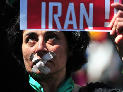 A woman demonstrates against the situation in Iran during the Christopher Street Day (CSD) gay pride parade in Berlin on June 19, 2010. Gays and lesbians around the world celebrate the Christopher Street Day (CSD) gay and lesbian pride parade, arguably the most important date in their calendar. AFP PHOTO …