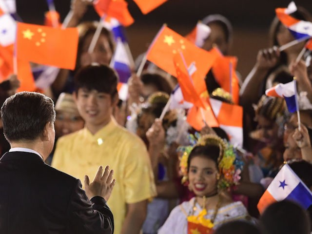 China's President Xi Jinping (L) waves at children upon landing at the airport in Panama City, on December 2, 2018. - Chinese President Xi Jinping visits Panama after attending the G20 Summit in Argentina. (Photo by Luis ACOSTA / AFP) (Photo credit should read LUIS ACOSTA/AFP via Getty Images)