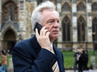 LONDON, ENGLAND - DECEMBER 12: Former Brexit Secretary David Davis speaks on his phone as he walks in Westminster on December 12, 2018 in London, England. Sir Graham Brady, the chairman of the 1922 Committee, has received the necessary 48 letters (15% of the parliamentary party) from Conservative MP's that …