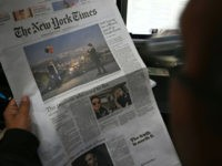 A Pakistani journalist reads a local edition of the International New York Times in Islamabad on February 12, 2019, which shows a single-column blank space on the front page. - An opinion piece in the International New York Times criticising Pakistan's powerful army was censored by its local publisher on …