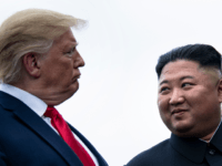 US President Donald Trump and North Korea's leader Kim Jong-un talk before a meeting in the Demilitarized Zone(DMZ) on June 30, 2019, in Panmunjom, Korea. (Photo by Brendan Smialowski / AFP) (Photo credit should read BRENDAN SMIALOWSKI/AFP via Getty Images)