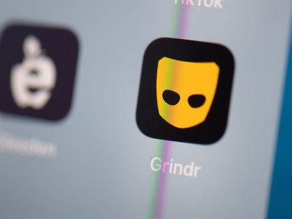 This illustration picture taken on July 24, 2019 in Paris shows the logo of the US social networking application Grindr on the screen of a tablet. (Photo by Martin BUREAU / AFP) (Photo credit should read MARTIN BUREAU/AFP via Getty Images)