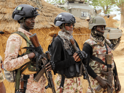 Nigerian Army soldiers stand at a base in Baga on August 2, 2019. - Intense fighting between a regional force and the Islamic State group in West Africa (ISWAP) has resulted in dozens of deaths, including at least 25 soldiers and more than 40 jihadists, in northeastern Nigeria. ISWAP broke …