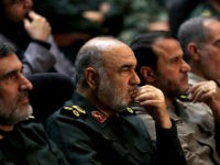 Iranian Revolutionary Guards commander Major General Hossein Salami (2-L) and General Amir Ali Hajizadeh (L), the head of the Revolutionary Guard's aerospace division, are pictured at Tehran's Islamic Revolution and Holy Defence museum, during the unveiling of an exhibition of what Iran says are US and other drones captured in …