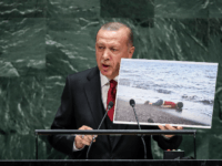 President of Turkey Recep Tayyip Erdogan holds up a photo of Alan Kurdi, a young Syrian refugee who drowned in the Mediterranean Sea while he and his family tried to reach Europe amid the European refugee crisis, while speaking the United Nations General Assembly at UN headquarters on September 24, …