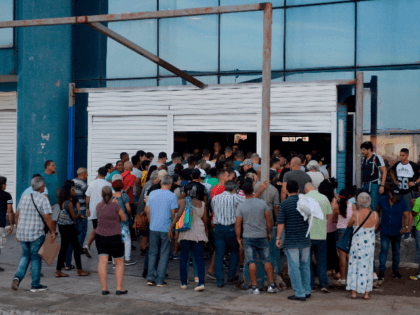 People queue to buy home appliances outside a store in Havana, on October 28, 2019. - A program to sell high-demand appliances in dollars started Monday in Cuba. (Photo by YAMIL LAGE / AFP) (Photo by YAMIL LAGE/AFP via Getty Images)