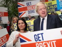 COLCHESTER, ENGLAND - DECEMBER 02: (L-R) Home Secretary Priti Patel, Prime Minister Boris Johnson and MP Will Quince hold a sign at a campaign rally event on December 2, 2019 in Colchester, England. (Photo by Hannah McKay - WPA Pool/Getty Images)