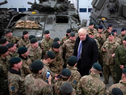 Britain's Prime Minister Boris Johnson speaks with the Queen's Royal Hussars (the senior United Kingdom armoured regiment) stationed in Estonia at the Tapa military base on December 21, 2019, during a one-day visit to the Baltic country. - Tapa military base is home to 850 British troops from the Queen's …