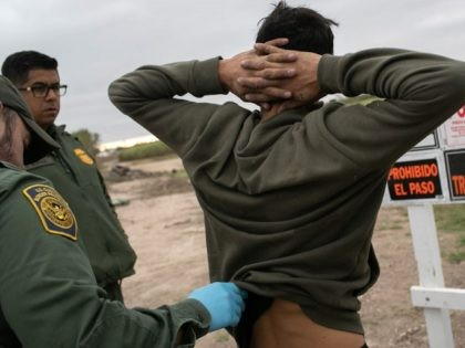 U.S. Border Patrol agents detain undocumented immigrants caught near a section of privately-built border wall under construction on December 11, 2019 near Mission, Texas. The hardline immigration group We Build The Wall is funding construction of the wall on private land along the Rio Grande, which forms the border with …