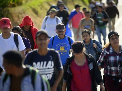 A group of Salvadoran migrants start their journey towards the United States in San Salvador, on January 20, 2020. (Photo by MARVIN RECINOS / AFP) (Photo by MARVIN RECINOS/AFP via Getty Images)