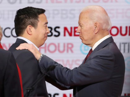 LOS ANGELES, CALIFORNIA - DECEMBER 19: Democratic presidential candidate Andrew Yang (L) speaks with former Vice President Joe Biden during the Democratic presidential primary debate at Loyola Marymount University on December 19, 2019 in Los Angeles, California. Seven candidates out of the crowded field qualified for the 6th and last …