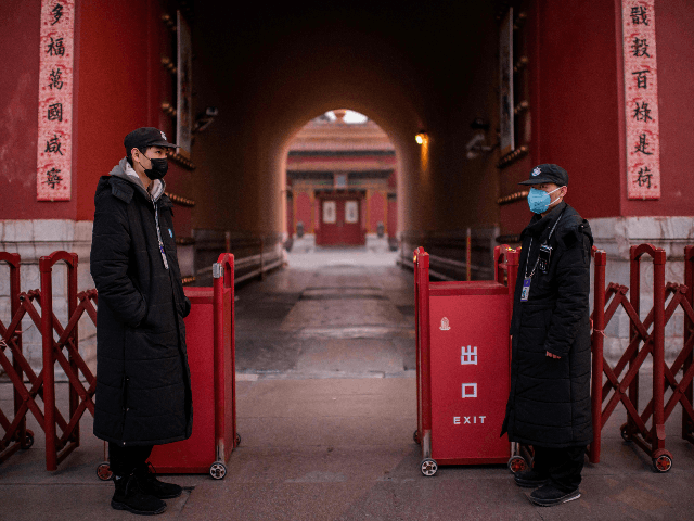 "Security guards wearing protective facemasks to help stop the spread of a deadly SARS-like virus which originated in the central city of Wuhan, stand at the exit of the Forbidden City (back) in Beijing on January 25, 2020. - China can ""win the battle"" against the virus epidemic that has …"