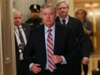 WASHINGTON, DC - JANUARY 29: Sen. Lindsey Graham (R-SC), C, walks toward the Senate chamber during the Senate impeachment trial at the U.S. Capitol on January 29, 2020 in Washington, DC. Wednesday begins the question-and-answer phase of the impeachment trial that will last up to 16 hours over the next …