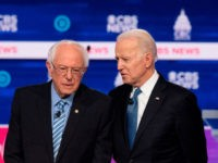 Democratic presidential hopefuls Vermont Senator Bernie Sanders (L) and Former Vice President Joe Biden (C) talk while Minnesota Senator Amy Klobuchar looks on ahead of the tenth Democratic primary debate of the 2020 presidential campaign season co-hosted by CBS News and the Congressional Black Caucus Institute at the Gaillard Center …